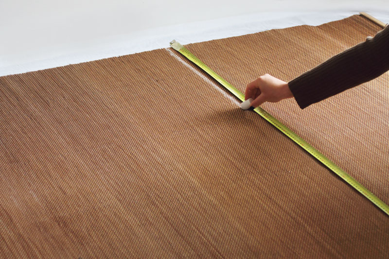 Measure and mark a chalk line across the width of your cane blind.