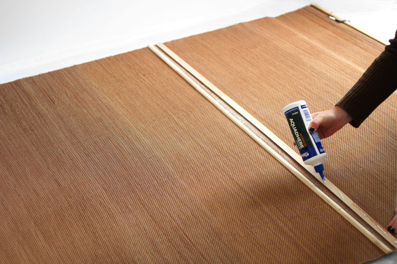 Glue the pine moulding to the cane blind using a wood glue