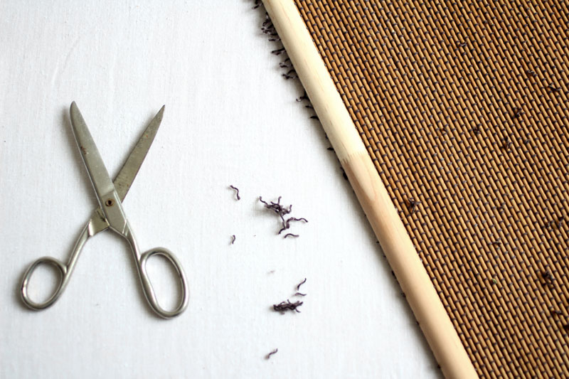 Using scissors, trim any excess thread from the edge of the blind.